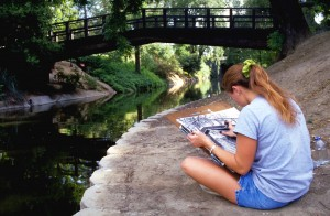 Debbie Aldridge/UC Davis An art student sketches along the east end of the arboretum.